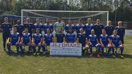 Godmanchester Rovers face the camera