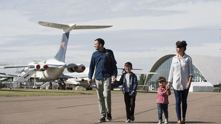 A family exploring IWM Duxford with the American Air Museum in the background. Picture: IWM