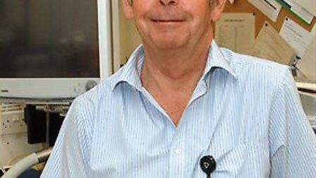 Jim McWilliams has put off his retirement to assist colleagues at Hinchingbrooke Hospital