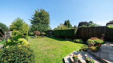The wonderful mature rear garden has views onto open fields. Picture: Bradford & Howley