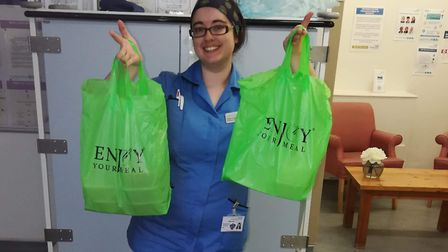 Nurse Gabi Lane-Brown with some free meals for NHS staff. Picture: Abul Chowdhury