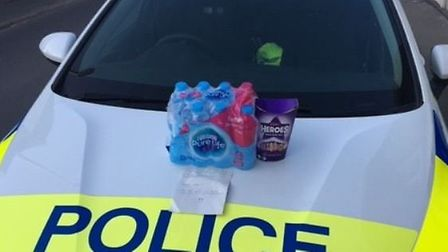 Melbourn Co-op workers donated water and a box of Heroes to the police. Picture: @SouthCambsCops