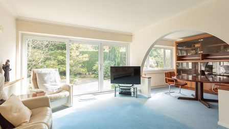 An archway connects the sitting room to the dining room. Picture: John Curtis
