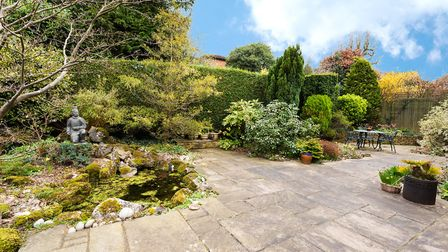The private, low-maintenance rear garden. Picture: John Curtis
