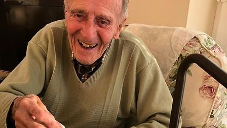 99 year old Reg Millns playing Scrabble PICTURE: Heathe