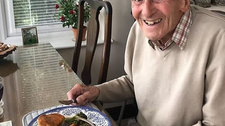99 year old Reg Millns having a roast dinner PICTURE: