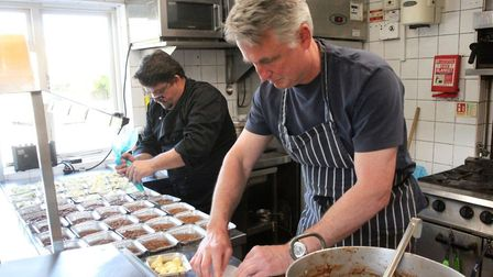 Paul Dyer in the kitchen making pies for the community