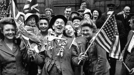 This iconic image was taken in London on VE Day, 1945, it shows Joan and Bette Kemp who had been giv