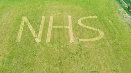 James Clark, from the Wyton Mower Centre, decided to make his own tribute to the NHS in a field at