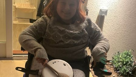 Julie Copeland's daughter Courtney from Therfield, who can't clap so uses a saucepan instead. Pictur
