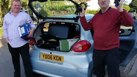 Andy Thomas and David Coton load Screenbank donations into a car. Picture; Courtesy of MVC