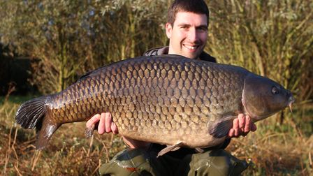 Mickey Bartlett, of St Ives Tackle, with a 39lb common carp caught last Autumn