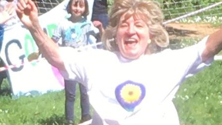 Trish Hall ran 104 laps of the Bernards Heath Junior School playing field and raised £2,000 for Up o