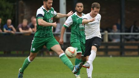 Marriott curls a left footed shot towards goal in the game between Royston Town v Biggleswade Town a