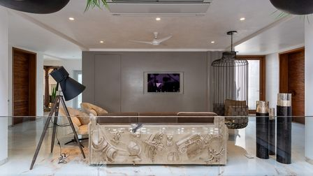 Lights, camera . . NA Architects created this lavish loft-style space furnished by Boca de Lobo. Pic