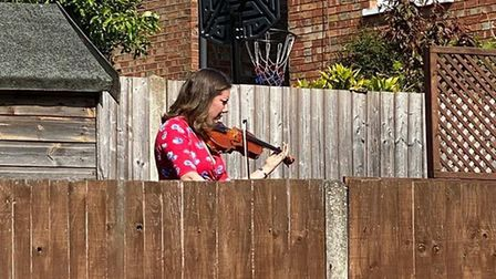 Violinist Leanne Sinha performed a concert for neighbours from her garden in St Albans.