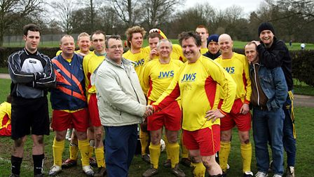 Alan Woodward being congratulated by his Dukes teamates on 500 appearances. Picture: BRIAN HUBBALL