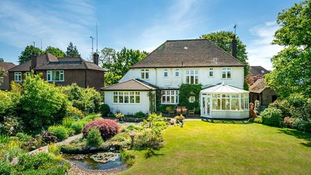 Features of the garden include two patio areas, a wild pond with waterfall, a further fish pond and