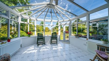 The light-filled conservatory opens onto the rear garden. Picture: Bradford & Howley