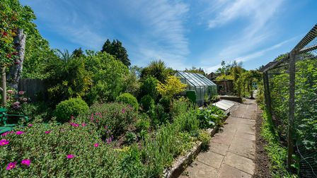 Additional features of the garden include a brick built air raid shelter with light and power and tw