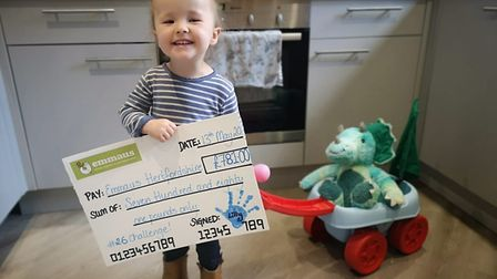 Lilly with her homemade cheque for Emmaus Hertfordshire.