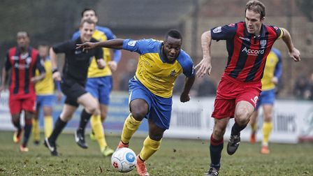 Junior Morias tries the break through the solid defense of Hampton. Picture: LEIGH PAGE