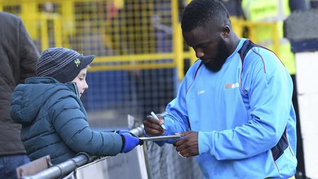 Junior Morias signs autogrpahs before his final game for St Albans City. Picture: BOB WALKLEY