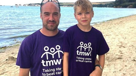 Pictured is Damien Whales and Ethan. A total of 270 people took part in last year's gruelling three-