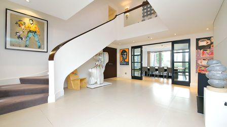 A large galleried entrance hall provides access to the main reception rooms at the £4.5m Newlands Av