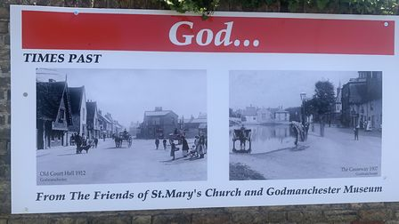 'God Bless Godmanchester' Posters displayed on the Vicarage Wall PICTURE: Mike Brown Ar
