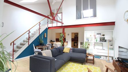 Features include a vaulted ceiling in the living/dining room and original metal beams. Picture: Hamp