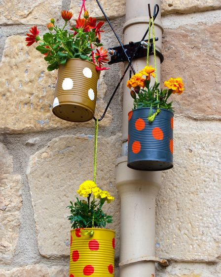 Old cans can be made into plant pots. Picture: iStock/PA