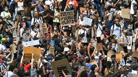 People take part in a Black Lives Matter protest in Trafalgar Square, London. Picture: Dominic Lipin