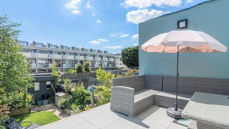 The south-facing roof terrace has views over the garden. Picture: Putterills