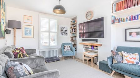 The living room has two feature chimney breasts and double-glazed sash windows. Picture: Putterills