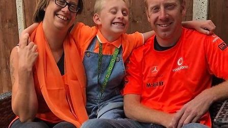 Cheyl, Ant and Harry Houghton are wearing orange to raise awareness about International Battens Dise
