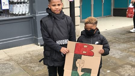 Jailen and Asher Harris from Huntingdon with their BLM placard.