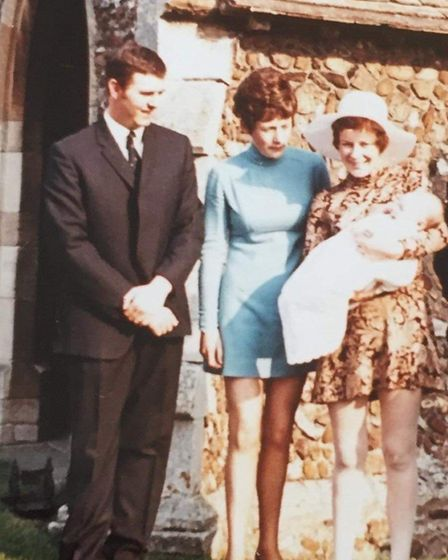 Stuart on his christening day with his mum, watched over by Judith and Stuart's father Ray. Picture: