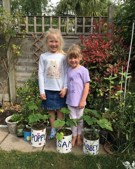 Poppy, age five, and Abbey, age three, with their plants for the Sustainable St Albans lockdown comp