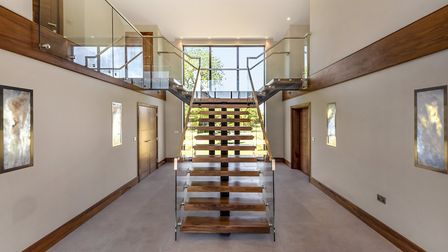 The spectacular 'floating' staircase is a breathtaking centrepiece of the property. Picture: Northwo