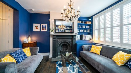 The original shopfront window adds unique character to the 22ft lounge. Picture: Paul Barker Estate