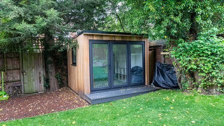 At the bottom of the garden is a stylish cabin, ideal as a home office. Picture: Paul Barker Estate
