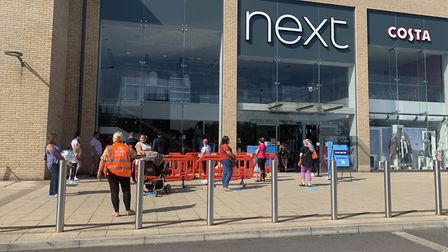 Queues outside Next in Huntingdon. PICTURE: