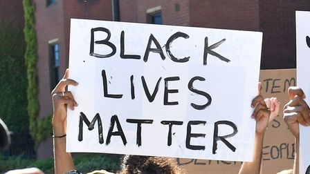 People take part in a Black Lives Matter protest outside the US Embassy in London. The protest follo