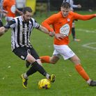 St Ives Town captain Robbie Parker finds himself under pressure during the FA Trophy clash with Soha