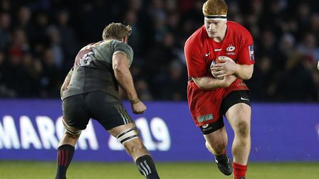 Ralph Adams-Hale of Saracens runs at Chris Robshaw of Harlequins during the Premiership Rugby Cup ma
