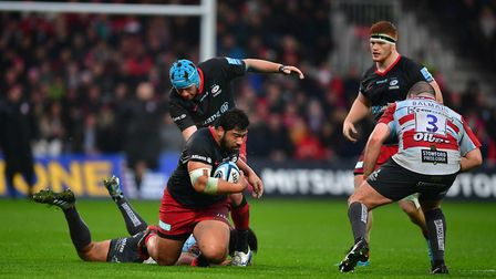 Saracens' Ralph Adams-Hale looks on (right) as Titi Lamositele is brought to ground during the Galla