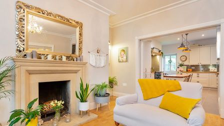 The living room has sash windows to the front, a coved ceiling and polished timber flooring. Picture