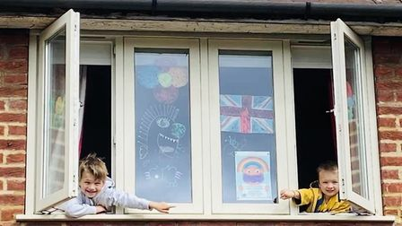 Erine and Albert Whitehead proudly display their Hippo drawings in aid of Home-Start Herts, Picture: