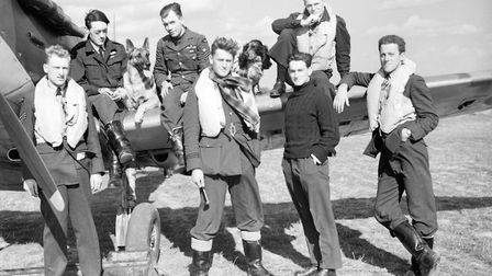 Pilots of No. 19 and No. 616 Squadrons pose alongside a Spitfire at Fowlmere, on September 21 1940.